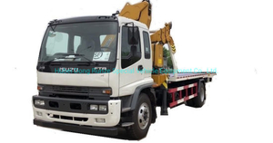 Japan. Brand I. S. U. Z. U Recovery Truck Mounted with Knuckle 5 Ton Crane and Roll Back Flatbed Wrecker Euro 5.6. Engine